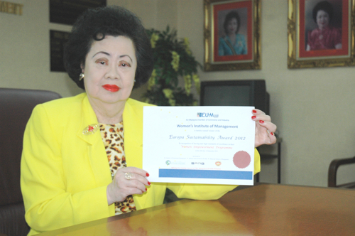 WIM was adjudged Winner of European Union-Malaysia Chamber of Trade & Commerce Sustainability Award 2012 in the Empowerment of Women Category. Picture Shows WIM's CEO, Dato Dr. Nellie Tan-Wong, holding the Certificate of Award